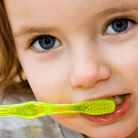 Girl-Brushing-Her-Teeth-1-compressor